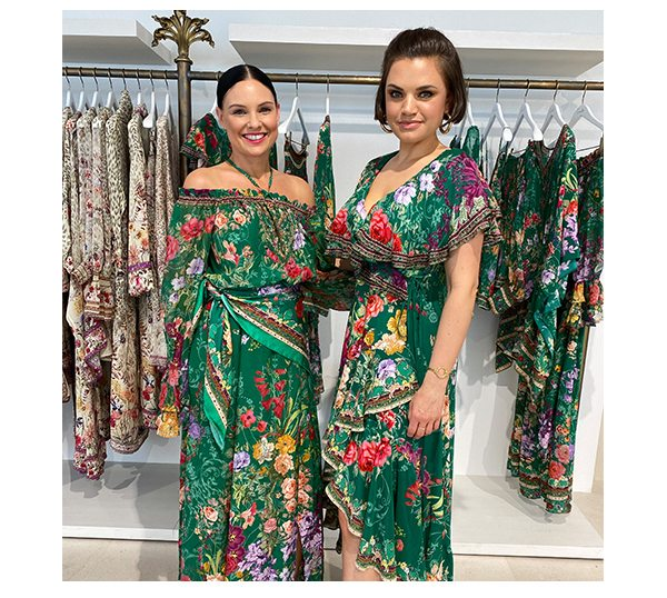 CAMILLA Stylist wearing green and floral maxi dresses, scarf tied around waist.