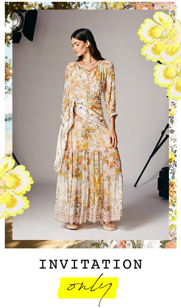 """""""Invitation Only"""" Model wearing CAMILLA yellow and white floral maxi dress with matching scarf."""
