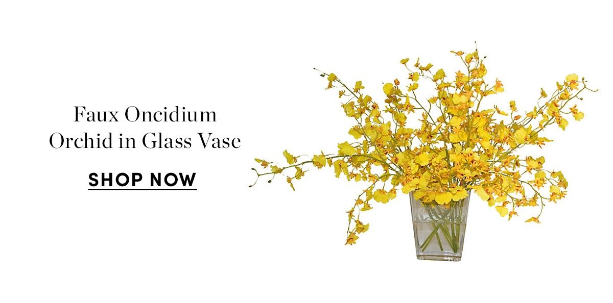 Faux oncidium orchid in glass vase