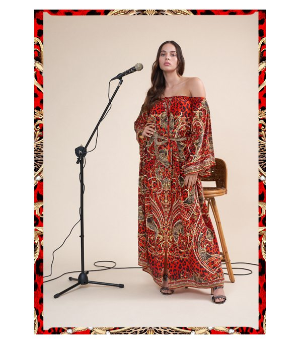 Model wearing slave to the rhythm keyhole neck long kaftan with microphone