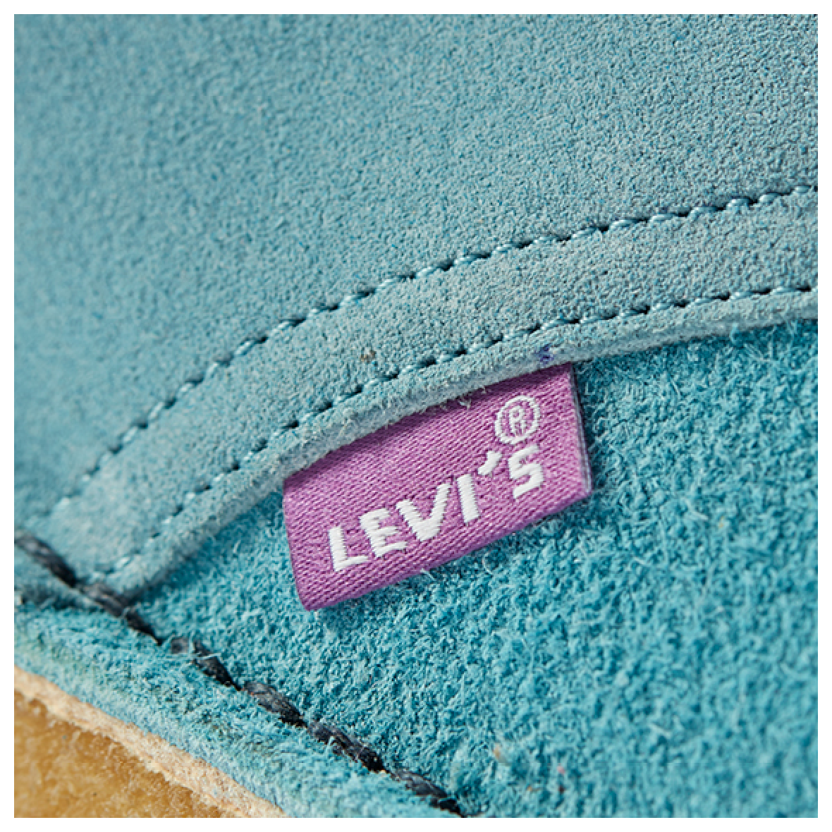 close up shot of the Desert Boot in pale blue combi links to product page