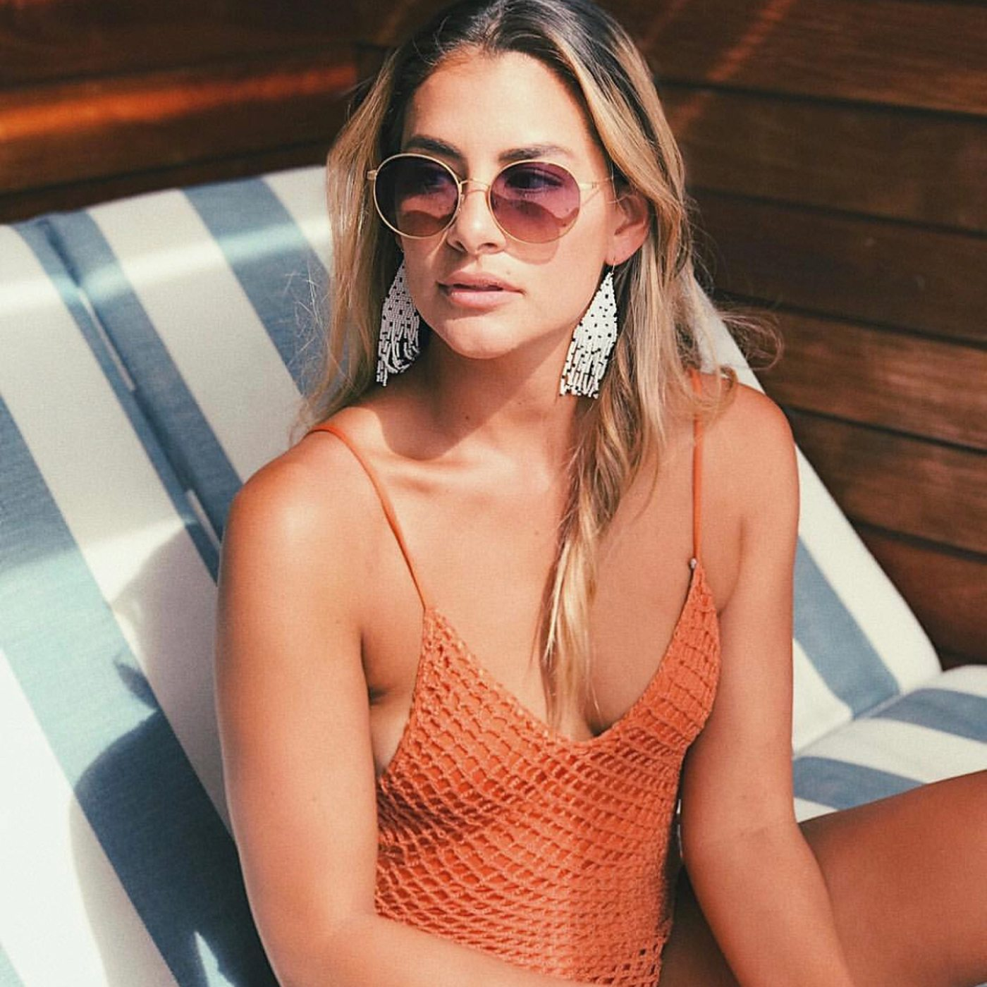 woman round wire sunglasses swimsuit summer