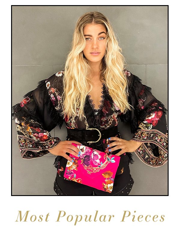 Model wearing black, gold pink floral lace up layer