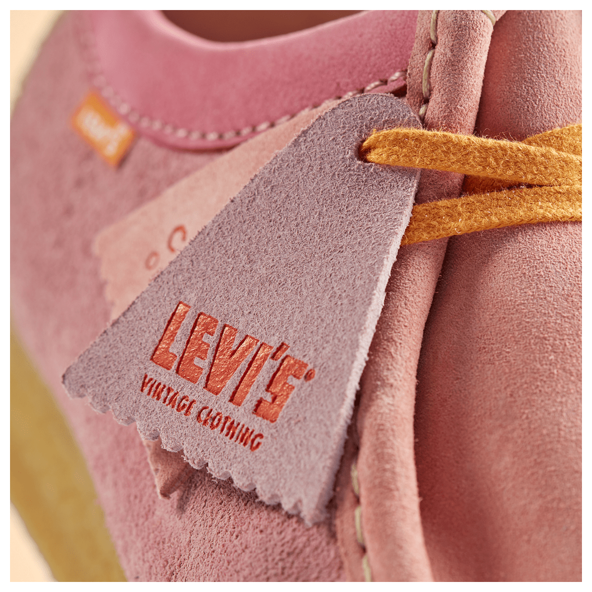 close up shot of the Wallabee in pink combi links to product page