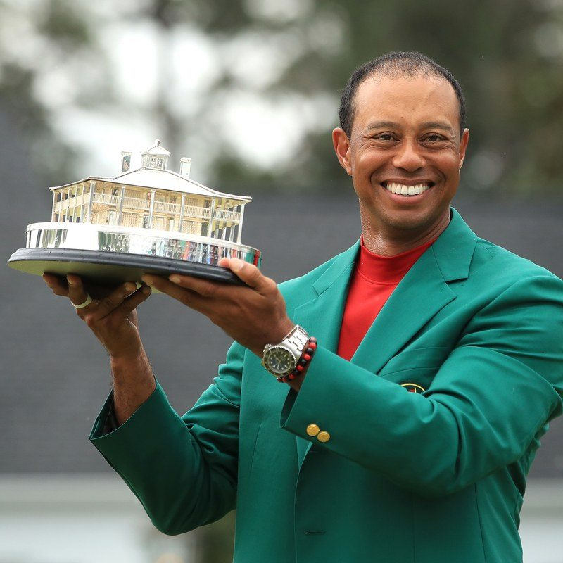 AUGUSTA, GEORGIA - APRIL 14: Tiger Woods of the United States celebrates with the Masters Trophy during the Green Jacket Ceremony after winning the Masters at Augusta National Golf Club on April 14, 2019 in Augusta, Georgia. (Photo by Andrew Redington/Getty Images)