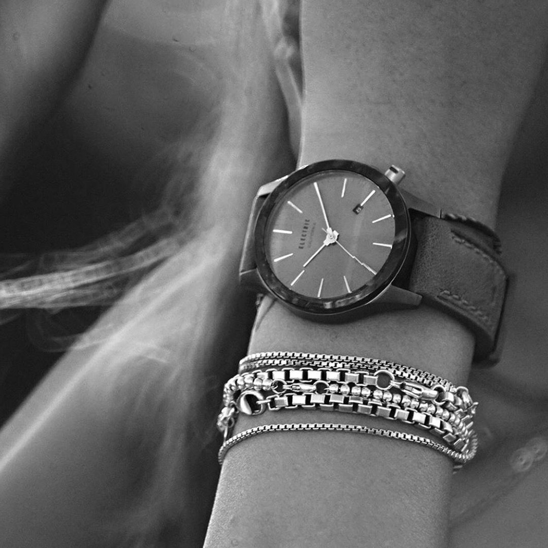 women's analog watch 50% off by Electric black and white photo